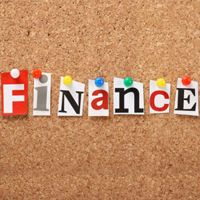 The word Finance on a cork notice board